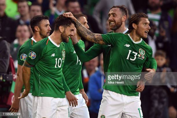 The Republic of Ireland celebrate with Robbie Brady after he scored during the 2020 UEFA European Championships group D qualifying match between the...