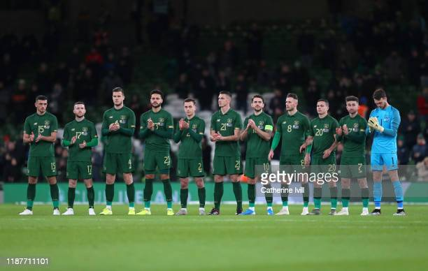 The Republic of Ireland team line up for a minutes applause ahead of the International Friendly match between Ireland and New Zealand at Aviva...