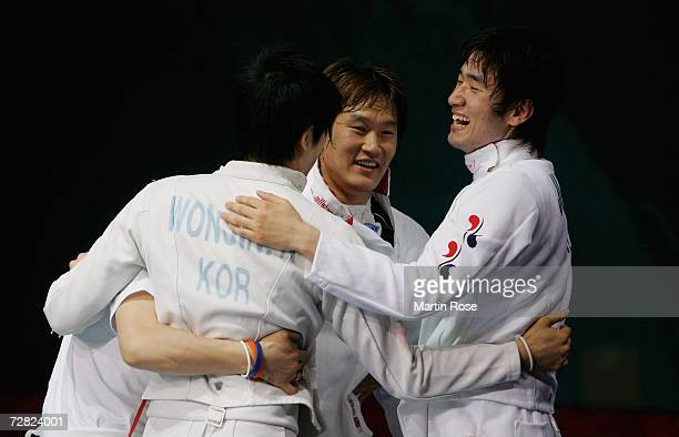 The Republic of Korea team celebrate their victory over China in the Men's Team Epee Gold Medal match during the 15th Asian Games Doha 2006 at the...