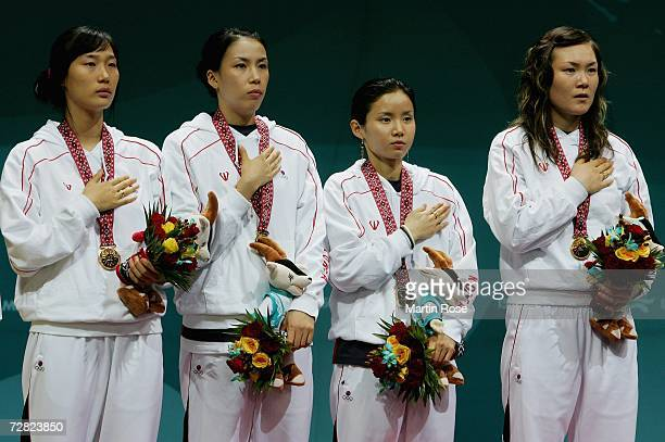 The Republic of Korea team celebrates their victory over China with their Gold Medals in the Women's Team Foil Gold Medal match during the 15th Asian...