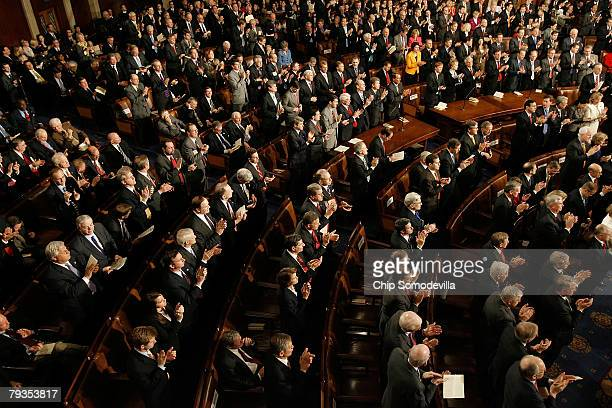 The Republican side of the House chamber stands and applauds as US President George W Bush delivers his State of the Union address at the US Capitol...