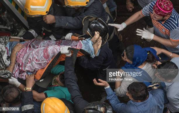 The rescued being taken to hospital after a fourstorey building Sai Darshan collapsed fourteen fire engines one rescue van and an ambulance have been...