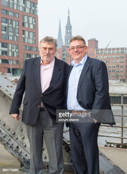 The rescued Karl-Heinz Meer and his son with the same name standing by the Speicherstadt in Hamburg, Germany, 26 January 2018. A unit of the US Air...