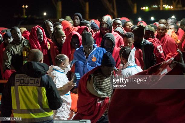 The rescued migrants being asked to leave the vessel by groups of 15 in order to be attended by the Red Cross Malaga The Spaniard Maritime vessel...