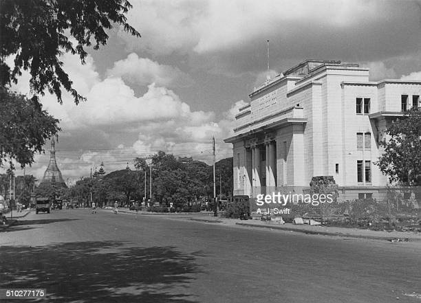 The Reserve Bank of India building in Rangoon Burma with the Sule Pagoda in the distance circa 1950