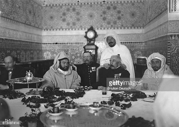 The resident general of Morocco, Louis Herbert Gonzalve Lyautey dines at the table of Sultan Mulai Yussef. Morocco, ca. 1925.