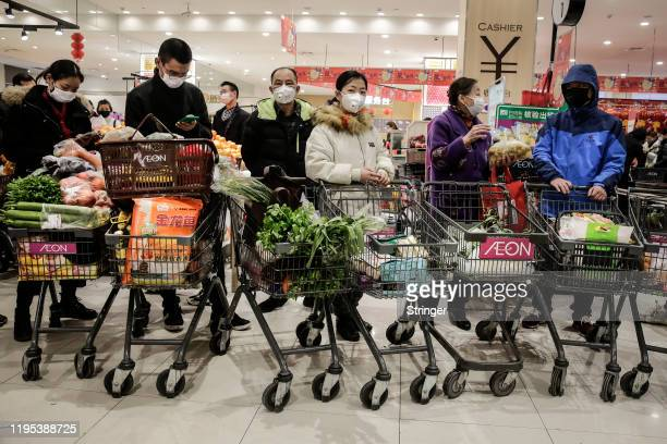 The resident wear masks to buy vegetables in the market on January 23th2020 in Wuhan Hubei£¬China Flights trains and public transport including buses...