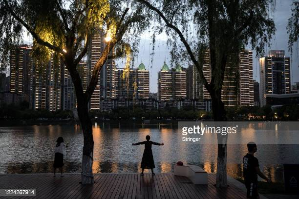 The resident womens physical exercise in Xibei lake park on May 11, 2020 in Wuhan, China. The government has begun lifting outbound travel...