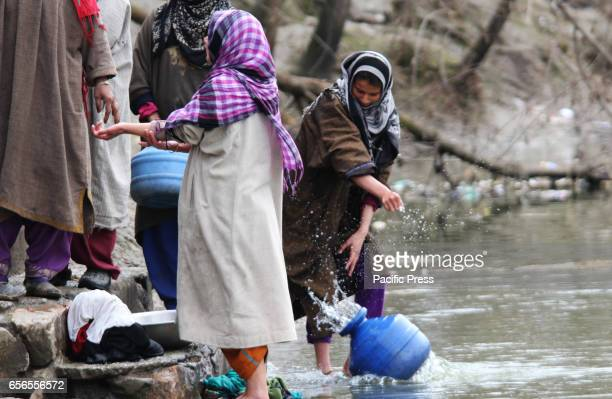 The residents fetched water in the river because of unavailability of the portable water through taps in Baramulla district