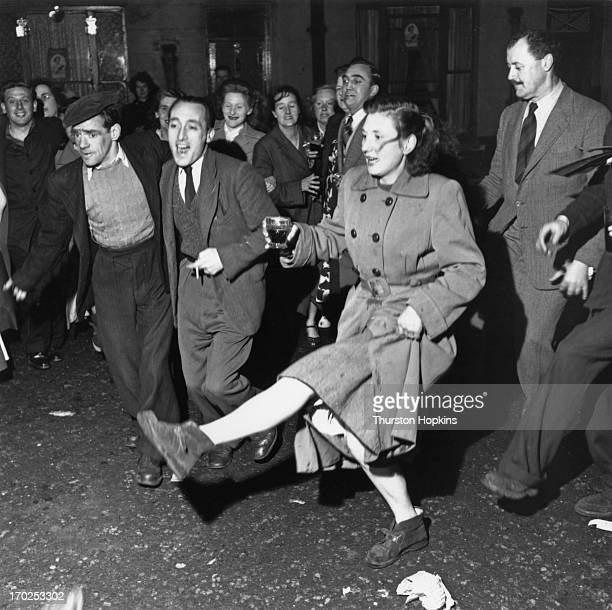 The residents of Hillimer Street Fulham dance at the street Coronation party 2nd June 1953 Original publication Picture Post 6537 A Fulham Coronation...