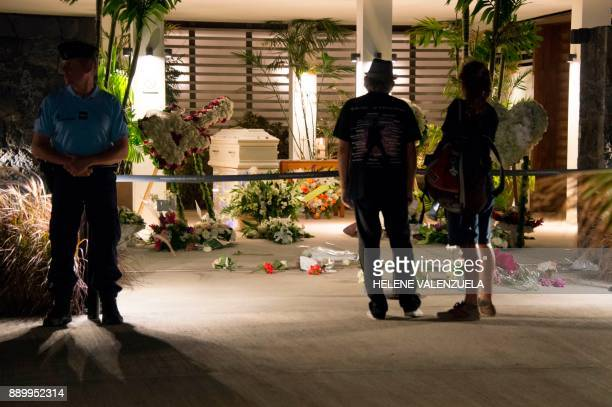 The residents of SaintBarthélemy pay a last tribute to French music icon Johnny Hallyday before his burial during the public wake at the Saint John...