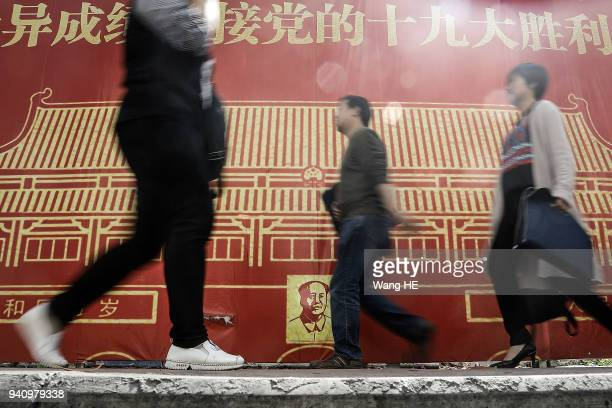 A women walks in front of Cucci store at SinoOcean Taikoo Li on April 22018 in Chengdu Sichuan province China