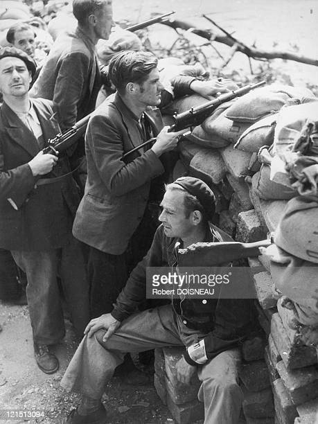 The Resistance Fighters Members Of The French Forces Of The Interior Protecting Themselves From German Attacks Behind Barricades Made Of Stones And...