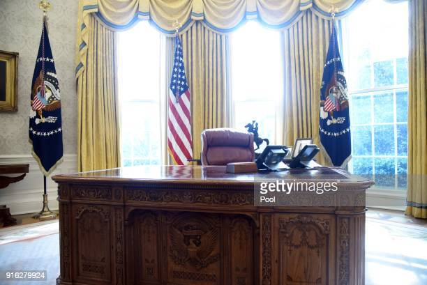 The Resolute desk is seen in the Oval Office of the White House February 9 2018 in Washington DC President Donald Trump gave a $10000 check to Don...