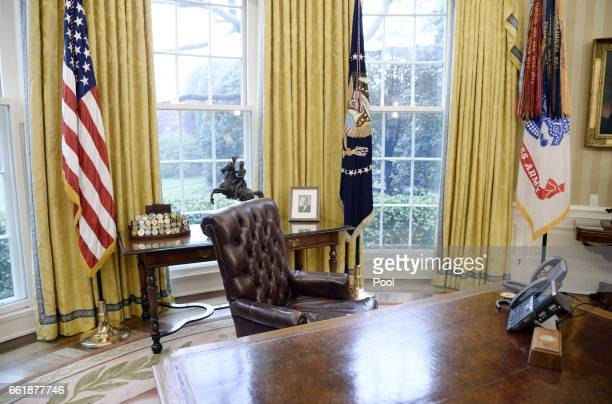 The Resolute desk is seen in the Oval Office of the White House March 31 2017 in Washington DC President Trump signed two executive orders that aim...