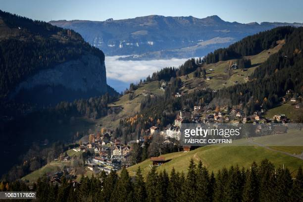 The resort of Wegen in the Swiss Alps is seen with a sea of clouds in the background on November 16, 2018.