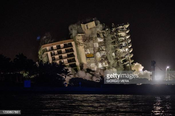 The rest of the Champlain South tower is seen being demolished in Surfside, Florida, north of Miami Beach, late on July 4, 2021. - A controlled...