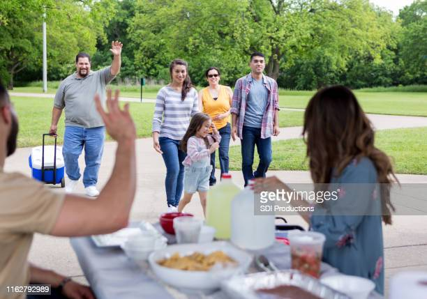 the rest of the family arrives and waves - pavilion stock pictures, royalty-free photos & images