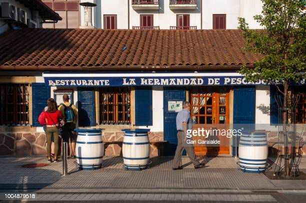 The Restaurante Hermandad de Pescadores located in the district of La Marina the fishing district of Hondarribia on July 24 2018 in Hondarribia Spain...