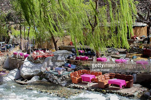 The restaurants for tourists in Ourika Valley are all built in the river bed or along it and set up with colourful sofas. Ourika Valley, near...