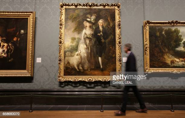 The restored painting by Thomas Gainsborough entitled The Morning Walk is pictured hanging on the walls of the National Gallery in London on March 28...