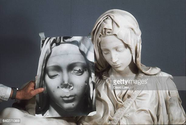 The restored Virgin Mary from Michelangelo's Pieta St Peter's Rome together with a photograph showing the statue's face prior to restoration |...