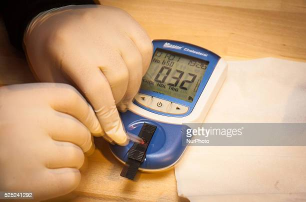 The result from a cholesterol screening is seen on a blood test monitor