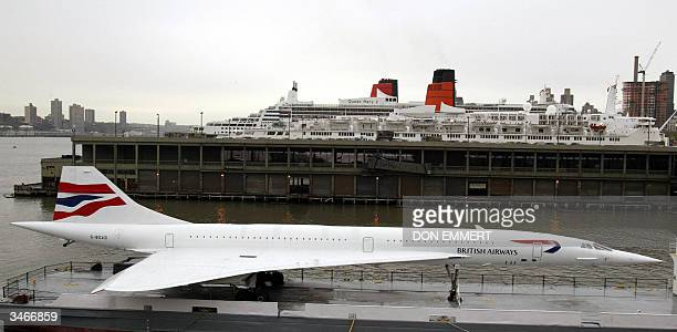 The retired British Airways Concorde sits with the Queen Mary 2 and the Queen Elizabeth 2 at port in New York City 25 April 2004 The two ships are...