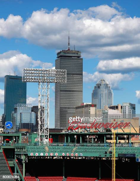 The retired number of former Boston Red Sox player David Ortiz sits below the Boston Skyline before the game against Los Angeles Angels at Fenway...