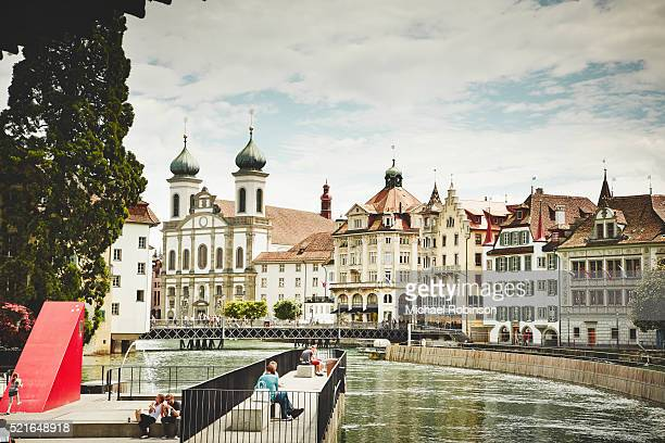 the reuss river running through lucerne switzerland - historic district stock pictures, royalty-free photos & images