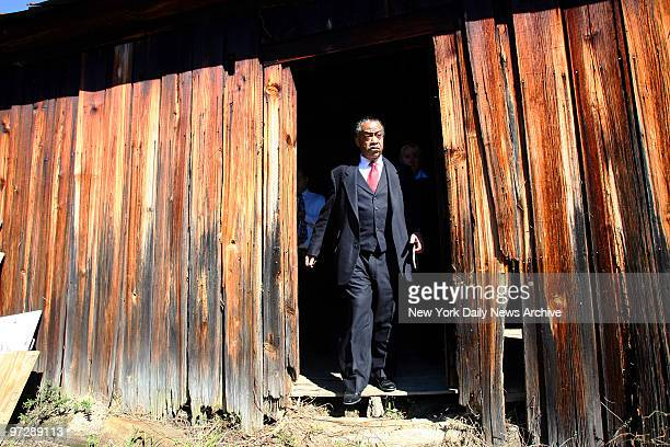 The Rev Al Sharpton exits the skeletal remains of a 200yearold tworoom slave shack on the property of Phillip White The land was once owned by a...