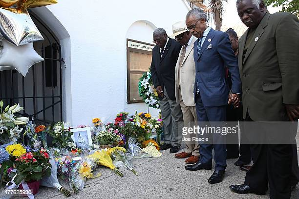 The Rev Al Sharpton holds a group prayer in front of the Emanuel African Methodist Episcopal Church after a mass shooting at the church that killed...