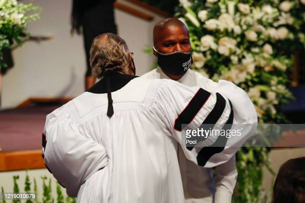 The Rev. Al Sharpton hugs actor Jamie Foxx during the funeral for George Floyd at The Fountain of Praise church on June 9, 2020 in Houston, Texas....