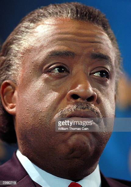 The Rev. Al Sharpton listens to a question during a town hall meeting of Democratic presidential candidates at the National Constitution Center...