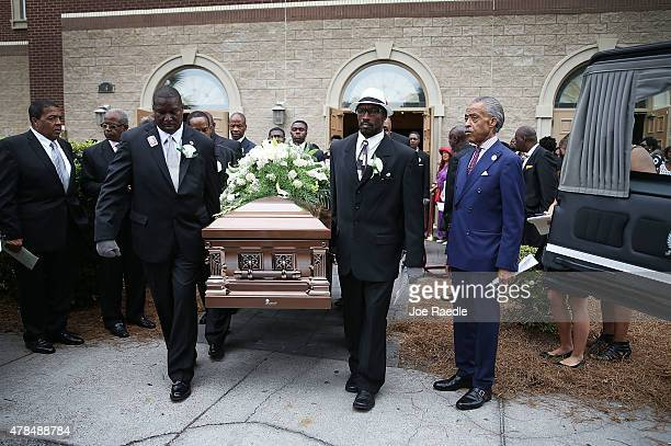 The Rev. Al Sharpton stands near the hearse as pallbearers carry the casket of Ethel Lance who was one of nine victims of a mass shooting at the...
