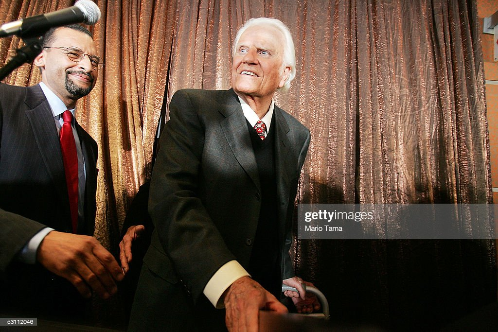 The Rev. Billy Graham smiles as he leaves a news conference about the upcoming Greater New York Billy Graham Crusade June 21, 2005, in New York City. The crusade will most likely be Graham's last mass event in the United States and will be held Friday to Sunday in Flushing Meadows Corona Park.