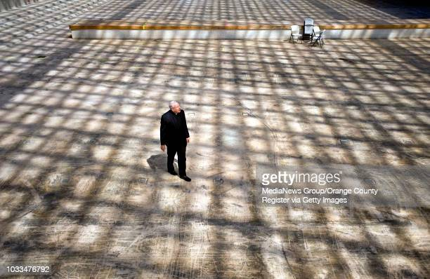 The Rev. Christopher Smith strolls what used to be the inside of Crystal Cathedral which is now under-going major rennovation by the Catholic Church....