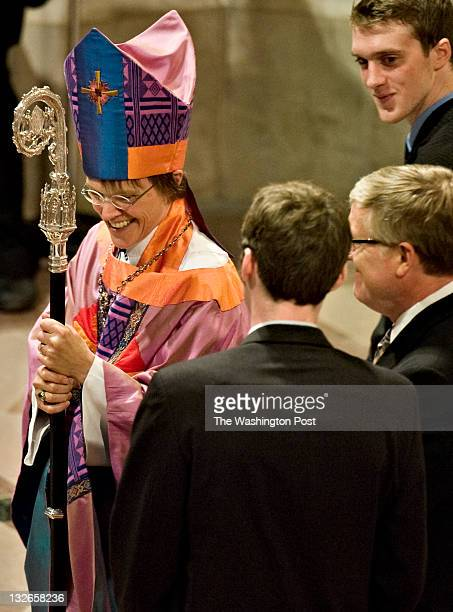 The Rev Dr Bishop Mariann Edgar Budde shares a laugh with her family during her consecration ceremony at the Washington National Cathedral in...