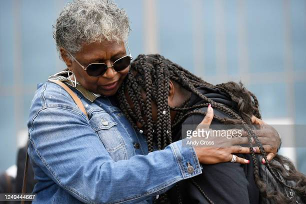 The Rev Dr Cheryl Williamson left comforts Samara McClain sister of Elijah McClain after a press conference in front of the Aurora Municipal Center...