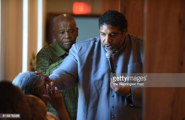 The Rev Dr William Barber II right blesses a mother alongside Minister Joe Barnes left during the Mother's Day service at Greenleaf Christian Church...