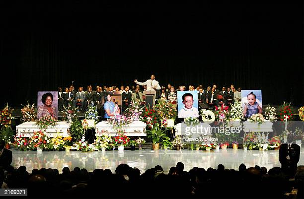 The Rev Eddie L Harper gives the eulogy at the funeral for five of his family members who were found shot to death in their home last week July 16...