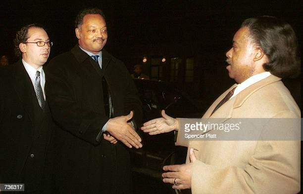 The Rev Jesse Jackson center shakes hands with the Rev Al Sharpton before heading into a prayer vigil for Jackson and his family at the Caanan...