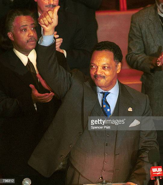 The Rev Jesse Jackson gives a thumbsup before speaking during a prayer vigil for himself and his family at the Caanan Baptist Church January 23 2001...
