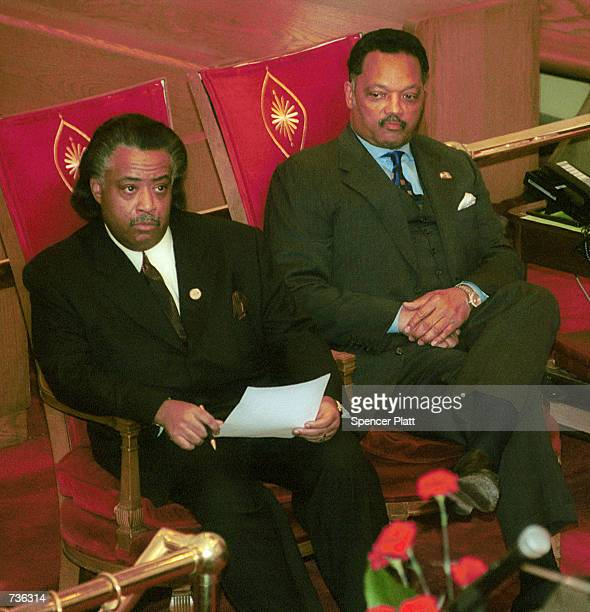 The Rev Jesse Jackson right sits with Rev Al Sharpton as they attend a prayer vigil for Jackson and his family January 23 2001 at the Caanan Baptist...
