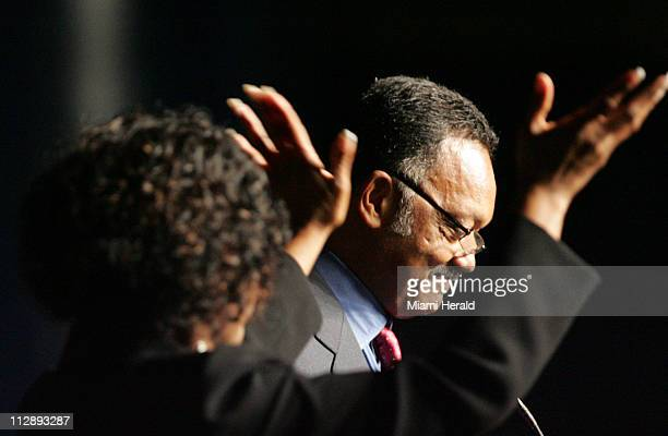 The Rev Jesse Jackson speaks to guests during the funeral services for Sean Taylor as a translator signs to the audience at the Pharmed Arena in the...