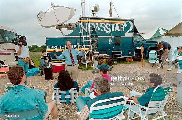 The Rev Jim Morisey of Waco holds an Easter Sunday service for members of the press on April 11 1993 at the roadside media encampment near the Branch...