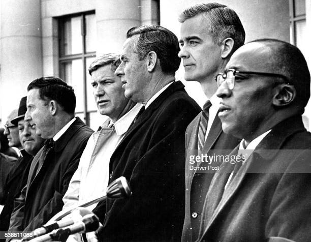 The Rev M C Williams right speaks at Memorial Service in Denver's Civic Center for Dr King Listening from left are Robbi Louis I Schecter who...