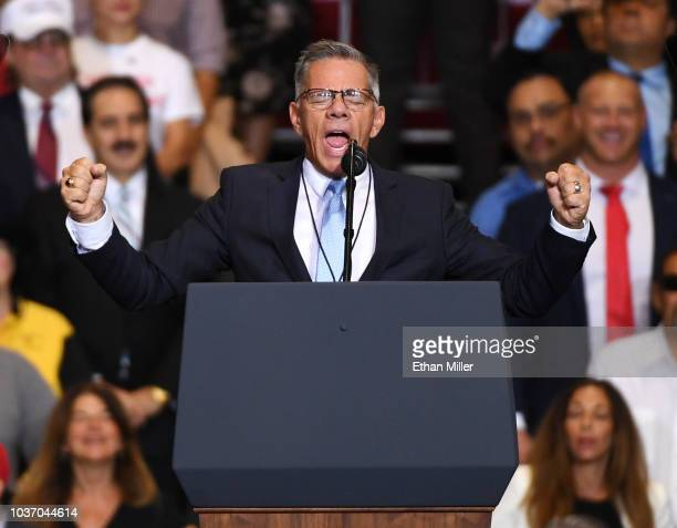 The Rev Paul Goulet leads the crowd in a prayer before a Donald Trump campaign rally at the Las Vegas Convention Center on September 20 2018 in Las...