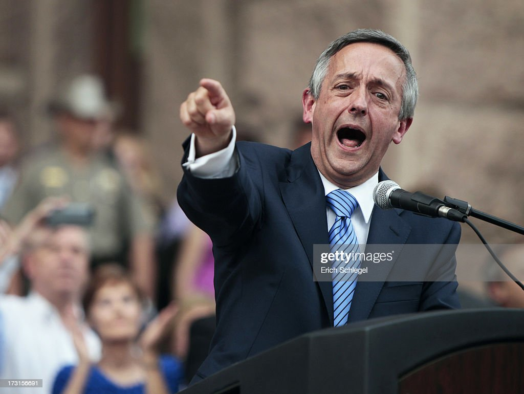 The Rev. Robert Jeffress, the controversial pastor of First Baptist Church in Dallas, energized the crowd by describing the debate over abortion as a fight 'between the kingdom of God and the kingdom of Satan,' as pro-life supporters and pro-choice protesters rally at the Texas state capitol in favor and against the new controversial abortion legislation up for a vote in the state legislature on July 8, 2013 in Austin Texas. Texas Gov. Rick Perry called on a second legislative special session to pass an restrictive abortion law through the Texas legislature. The first attempt was defeated after opponents of the law were able to stall the vote until after first special session had ended.