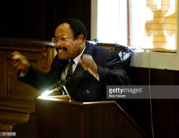 The Rev Walter Oliver pastor of The Bible Speaks Ministries talks with congregants about his trial Sunday morning November 9 2003 in Beacon Falls...